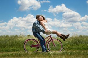 Couple in a relationship riding a bike