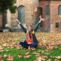 Girl tossing leaves in the air
