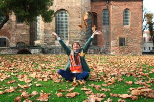 Girl tossing leaves while in Eating Disorder Treatment