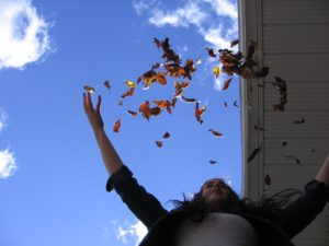 Woman with anxiety throwing leaves in the air