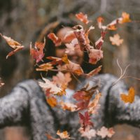Woman throwing leaves to Focus on Life