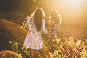 Two girls standing in the sun on a farm in anorexia recovery