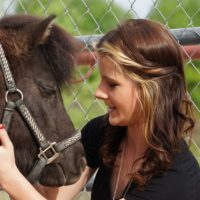 Girl Petting Horse in Equine Therapy