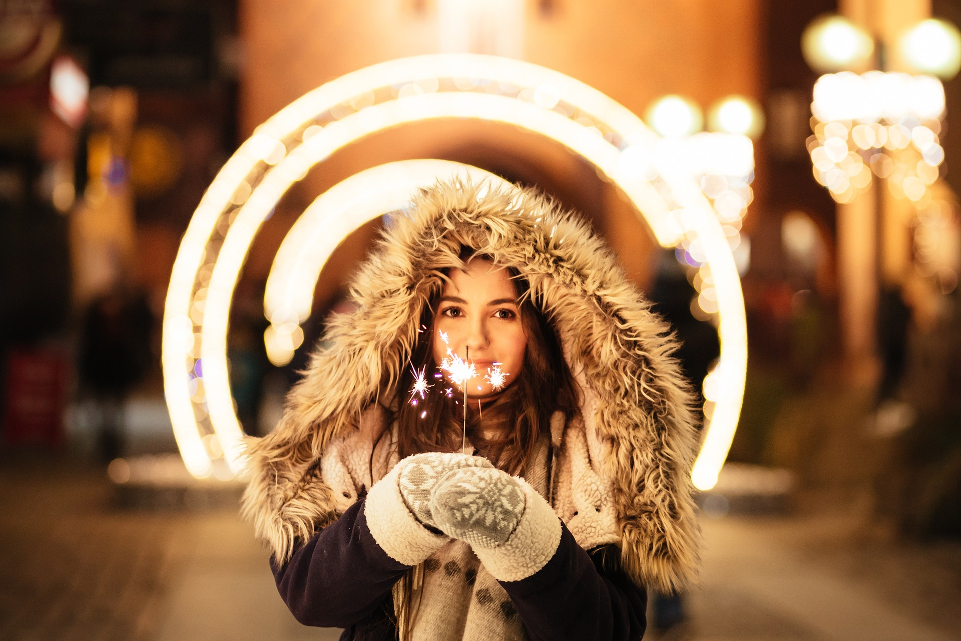 Woman holding holiday lights