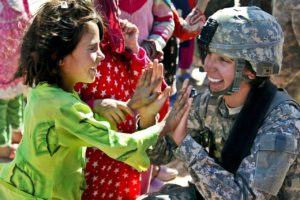 Woman veteran playing with little girl