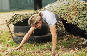 Woman with PTSD and eating disorder in obstacle course