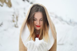 Woman holding snow
