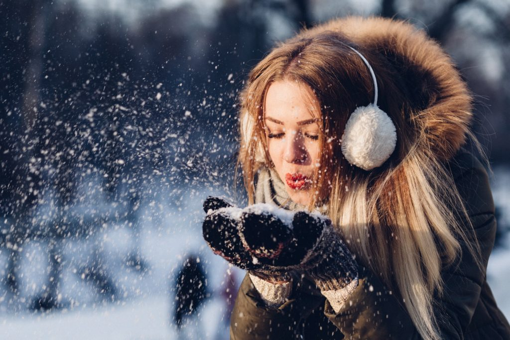Woman with ear muffs