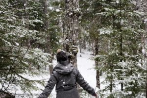 Woman in woods during the holidays
