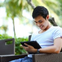 Man researching exposure-based therapy on his iPad