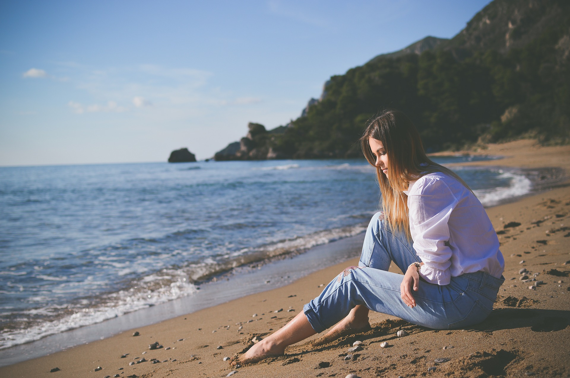 Woman sitting on a beach Bargaining in Eating Disorder Recovery