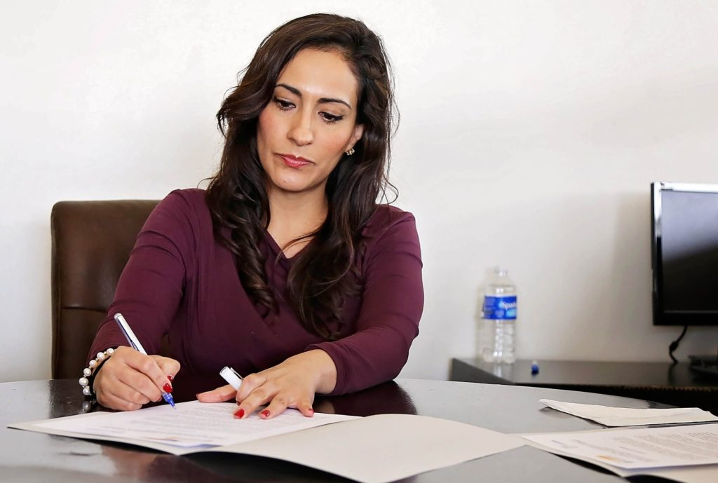 Woman compiling notes on Gender Issues