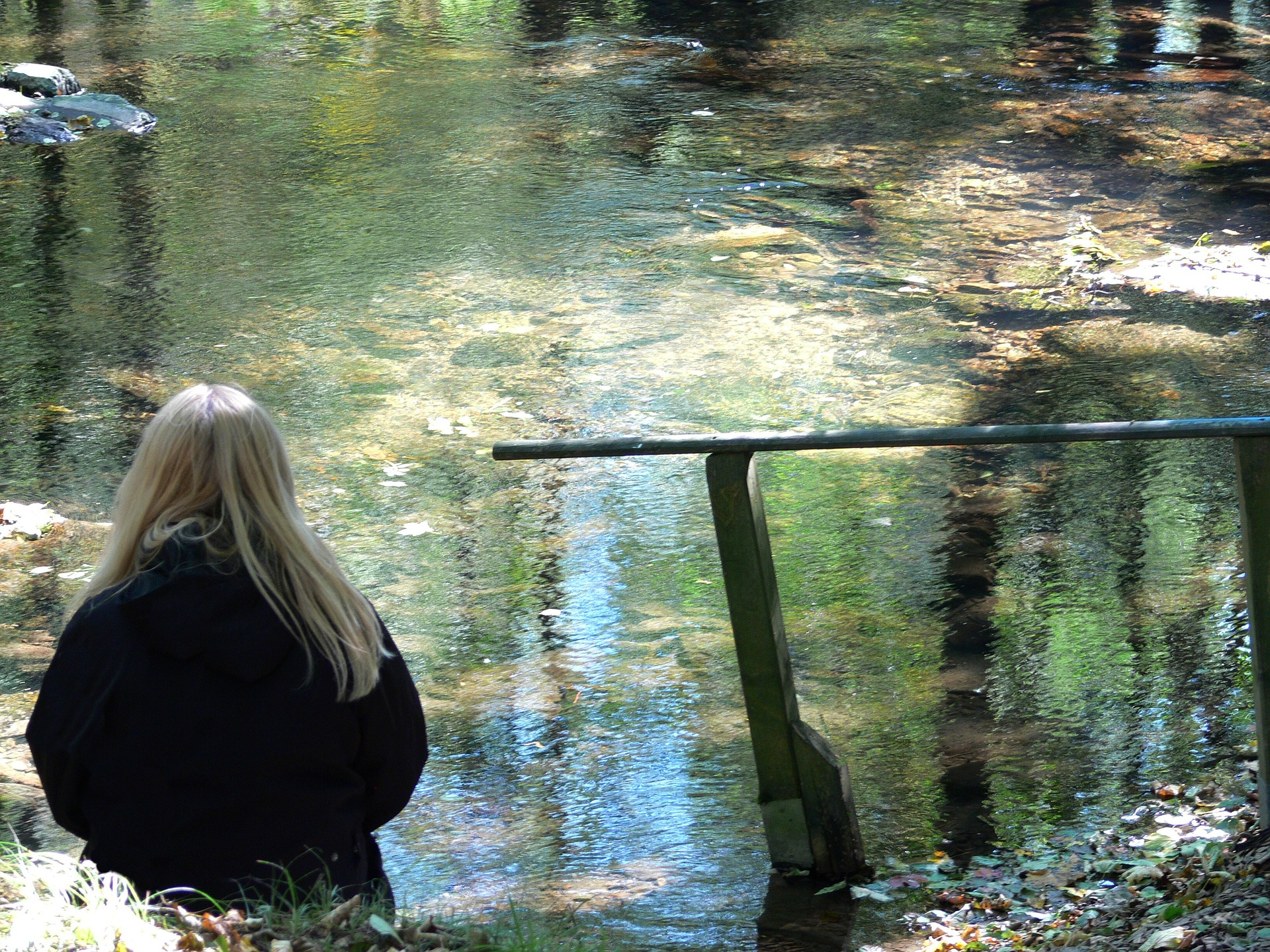 Woman by the river thinking about Eating Disorders in Transgender Women