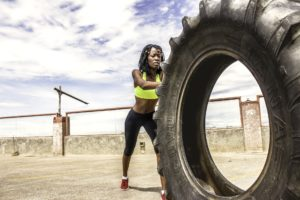 Lady Exercising and thinking about movement in eating disorder recovery