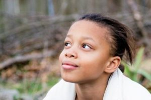 Young African-American girl looking to the future