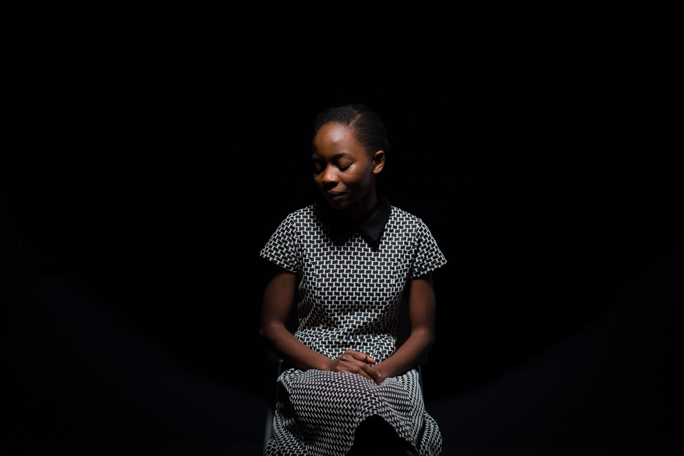 Black Woman thinking about child in Anorexia Recovery