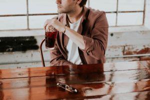 Man drinking sugar-sweetened beverages