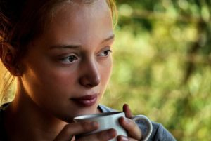 Girl Drinking Cup of Coffee thinking about eating disorders