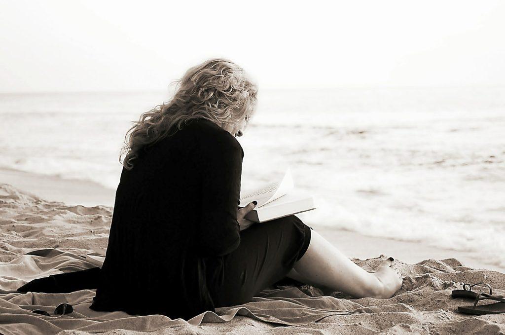 Lady sitting on a beach