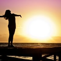 Woman standing on the beach having a positive self-talk