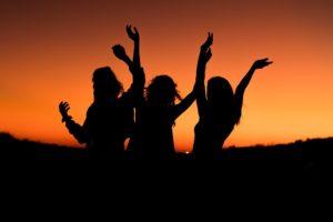 Ladies Dancing at Sunset