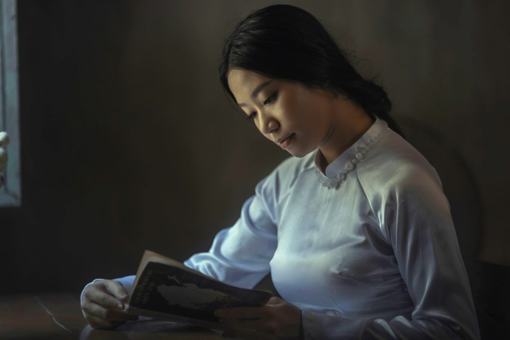 Asian American Woman or Girl Reading a Book