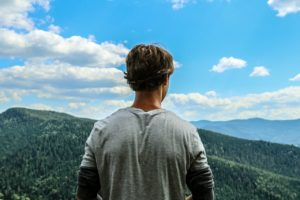 Guy Looking At Mountains