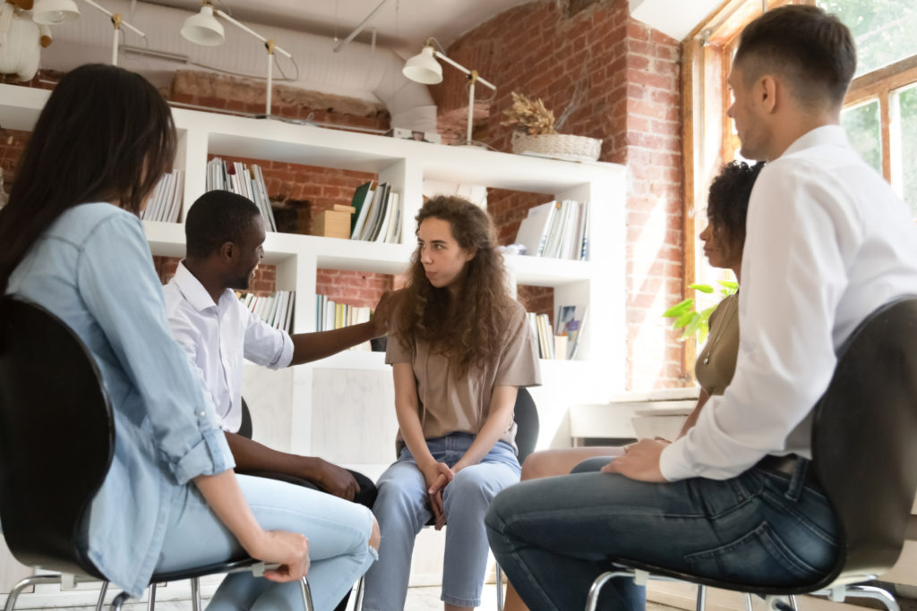 Young Lady in Group therapy after Returning to Eating Disorder Treatment