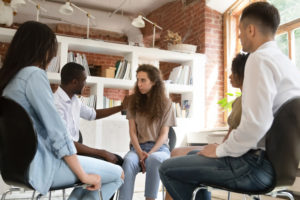 Young Lady in Group therapy after dealing with Depression and Eating Disorders