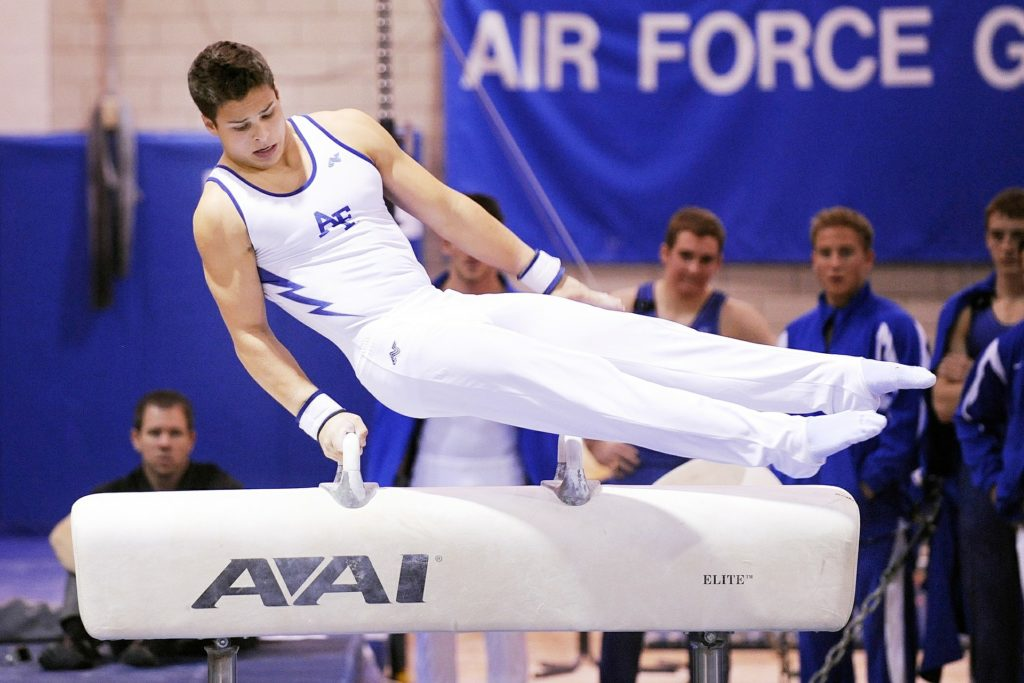 Male on Pommel Horse representing binge eating disorder and male athletes fighting EDs