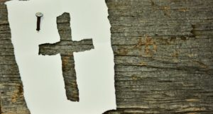 Cross tacked on a piece of wood