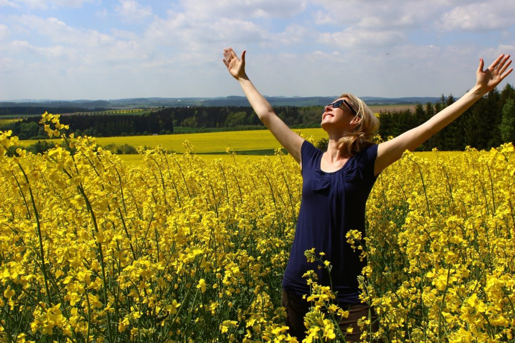 Lady in field experiencing feelings in eating disorder recovery