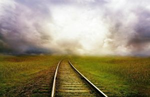 Nature Railroad Tracks into Stormy Clouds