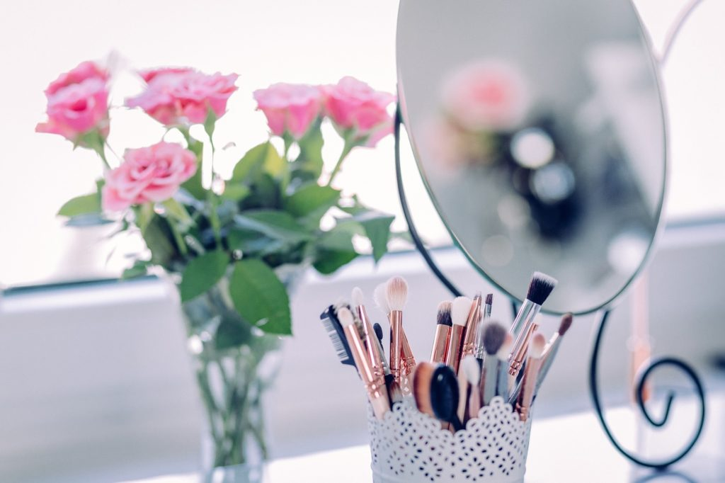 Mirror with Makeup and Roses