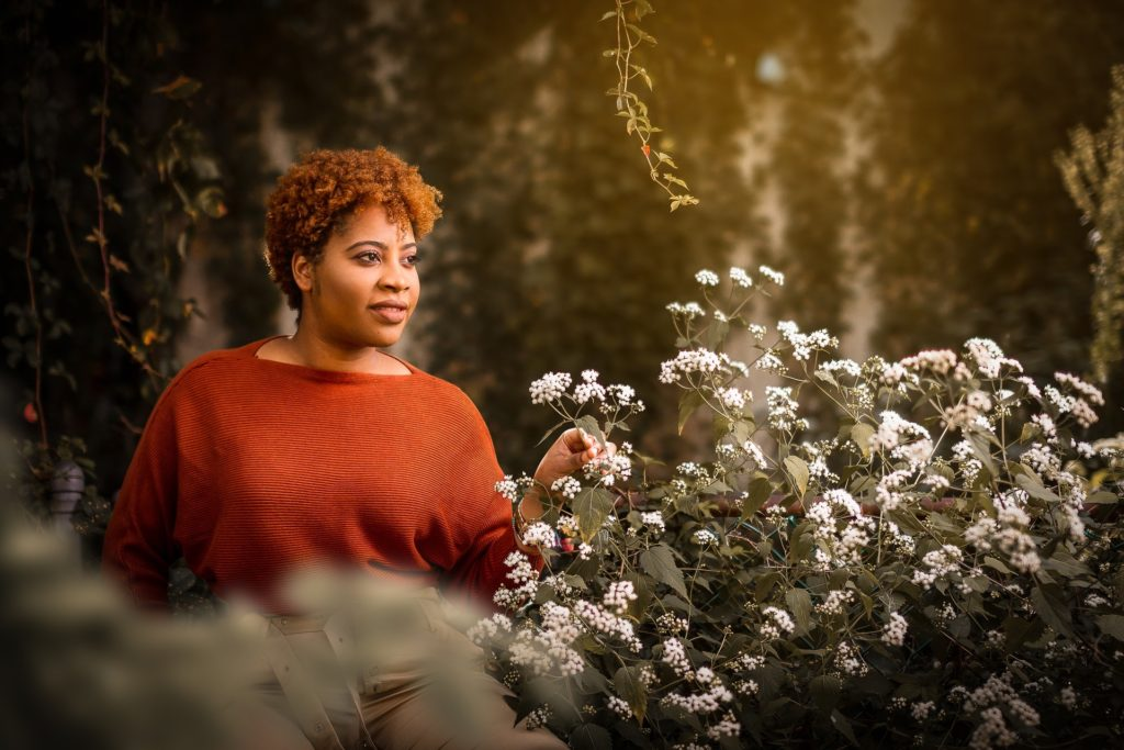 African American Black Woman in Front of Plant