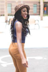 African American Black Woman in LV Hat Blue Tank Top