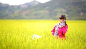 Asian woman in yellow field of flowers fighting Depression and eating disorders