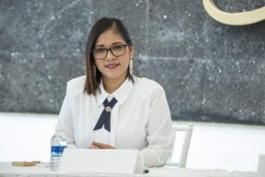 Hispanic Woman in Business Meeting Room
