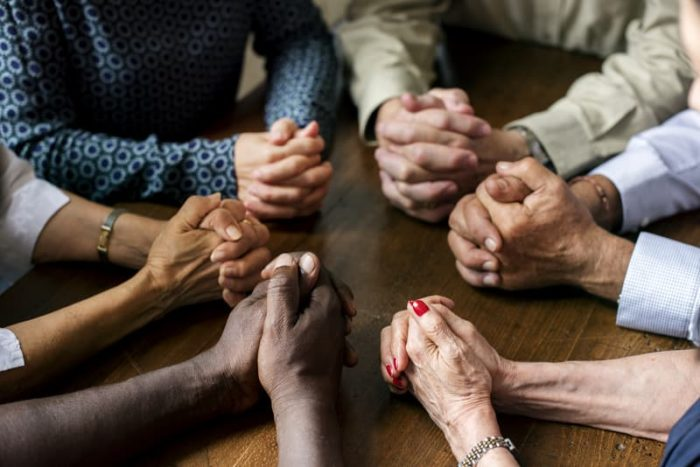 Group Holding Hands Together