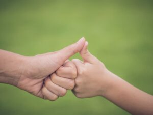 Thumbs Touching for Support