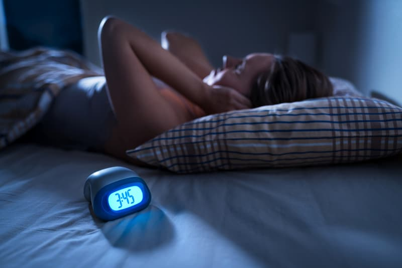 Woman in bed unable to sleep