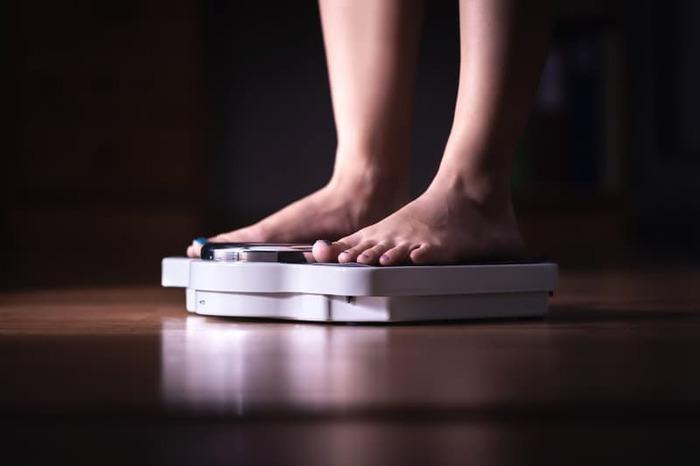 Women Weighing Herself